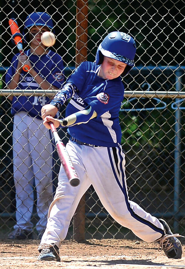 Hour photo / Erik Trautmann Norwalk player Mike Berkowitz gets an RBI single during the Cal Ripken 11s state championship game vs Newtown Saturday at Tim Devine Field in Norwalk
