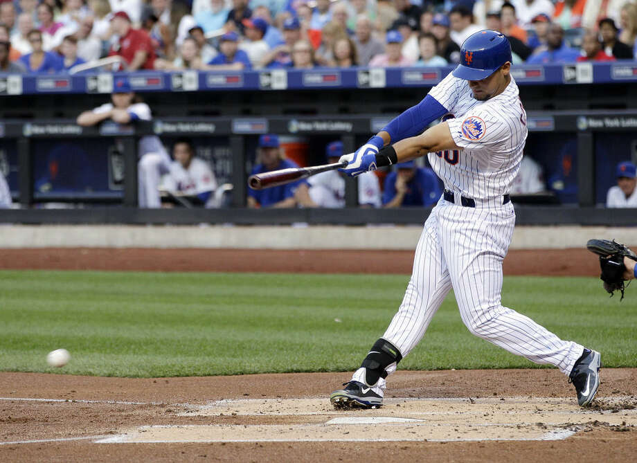 New York Mets' Michael Conforto hits an hits an RBI-single during the first inning of a baseball game against the Los Angeles Dodgers, Saturday, July 25, 2015, in New York. (AP Photo/Frank Franklin II)