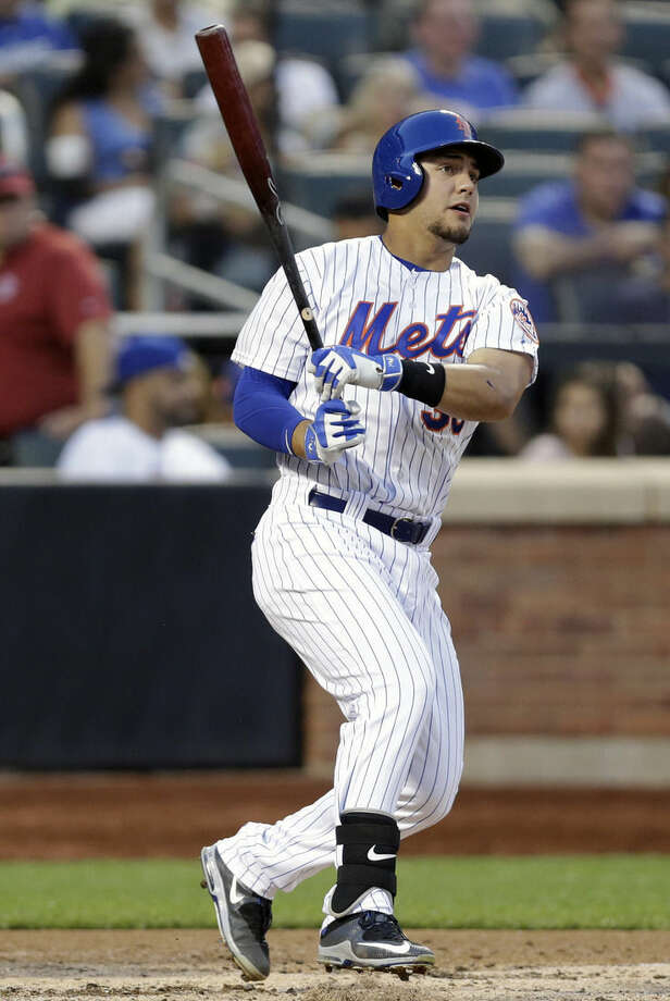 New York Mets' Michael Conforto hits a double during the third inning of a baseball game against the Los Angeles Dodgers, Saturday, July 25, 2015, in New York. (AP Photo/Frank Franklin II)