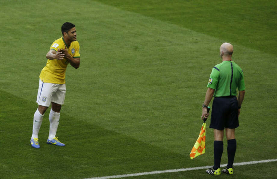 Brazil's Fred argues with the assistant referee after his goal was disallowed due to a handball during the World Cup round of 16 soccer match between Brazil and Chile at the Mineirao Stadium in Belo Horizonte, Brazil, Saturday, June 28, 2014. (AP Photo/Hassan Ammar)