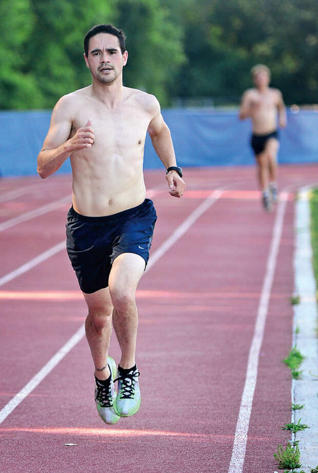 Hour photo / Erik Trautmann James Osborne wins the first of 10 Westport Road Runners races Saturday, a 2.3 mile race at Staples High School.