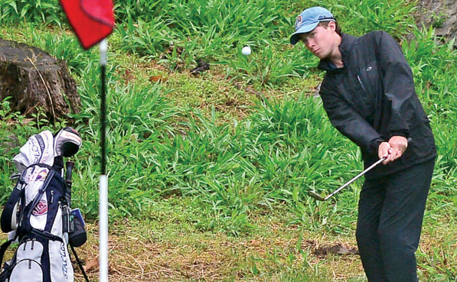 Hour photo / Erik Trautmann Staples' Peter Richards chip onto two during the Cappa Golf Tournament at Longshore Park in Westport earlier this year.