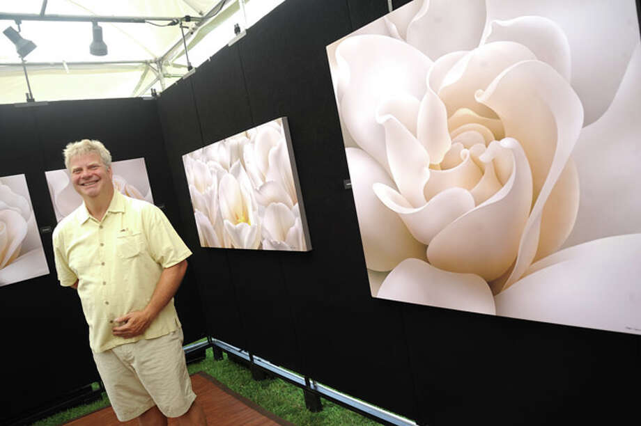 Edward Loedding with his work called 'Visual Choreography' Sunday at the Norwalk Art Festival held at Mathews Park. Hour photo/Matthew Vinci