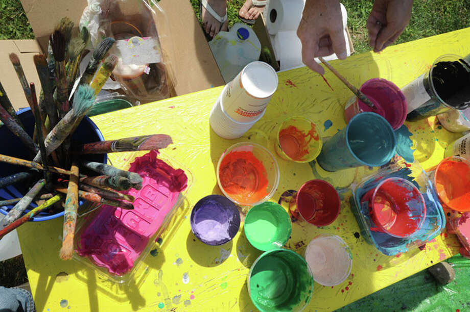 Painting supplies available to everyone to use from the Firing Circuits Studios Sunday at the Norwalk Art Festival held at Mathews Park. Hour photo/Matthew Vinci