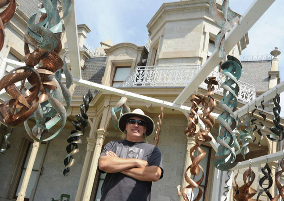 Craig Riches with his hanging sculpture works Sunday at the Norwalk Art Festival held at Mathews Park. Hour photo/Matthew Vinci