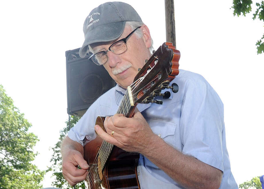Musician Edward Wright plays for the crowds attending on Sunday at the Norwalk Art Festival held at Mathews Park. Hour photo/Matthew Vinci