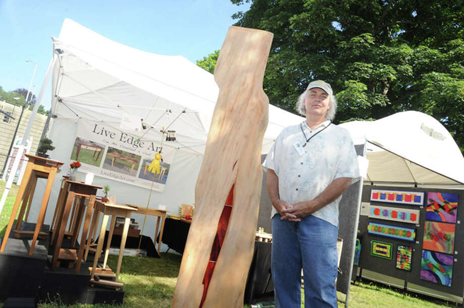 Woodworker and artist David Hallmark with a piece called 'Stand Tall' Sunday at the Norwalk Art Festival held at Mathews Park. Hour photo/Matthew Vinci