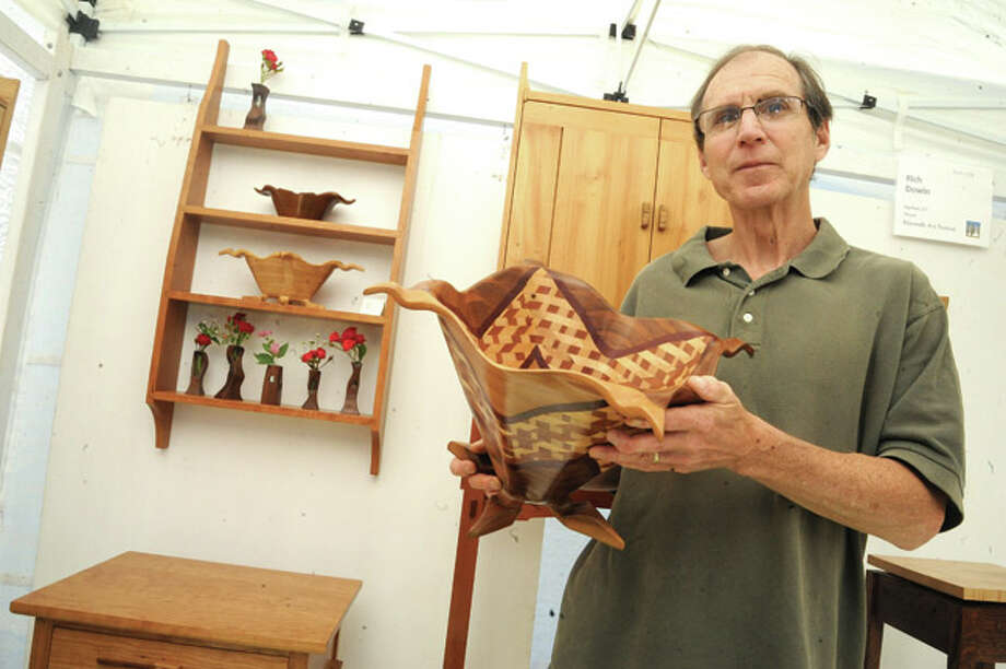 Rich Dowin, woodworker and artist Sunday at the Norwalk Art Festival held at Mathews Park. Hour photo/Matthew Vinci
