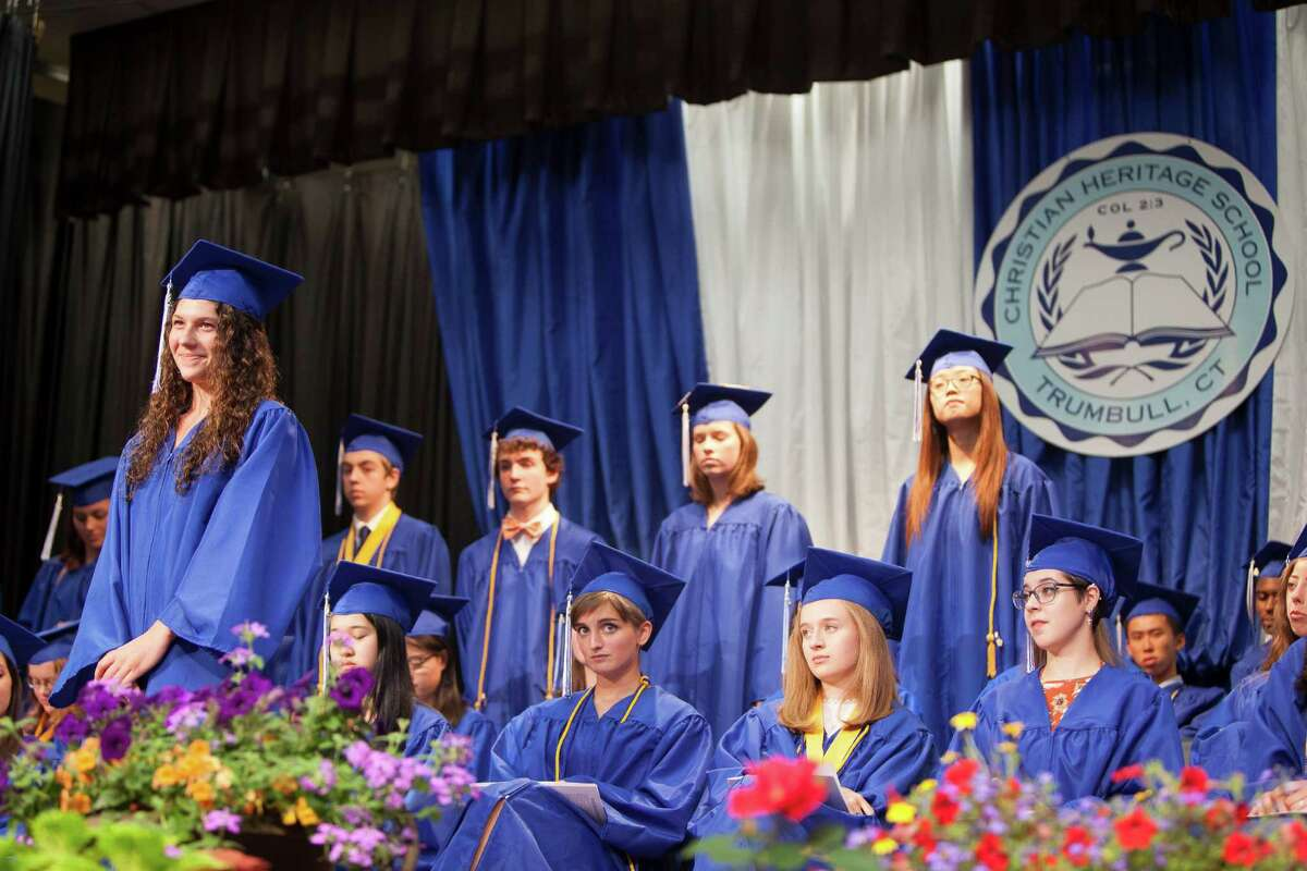 Emma Greer stands as an audio recording is played aloud wishing her best wishes from a member of the school's staff at the Thirty-Third Commencement Exercises of Christian Heritage School took place in Trumbull, Conn. on Saturday, June 11, 2016.