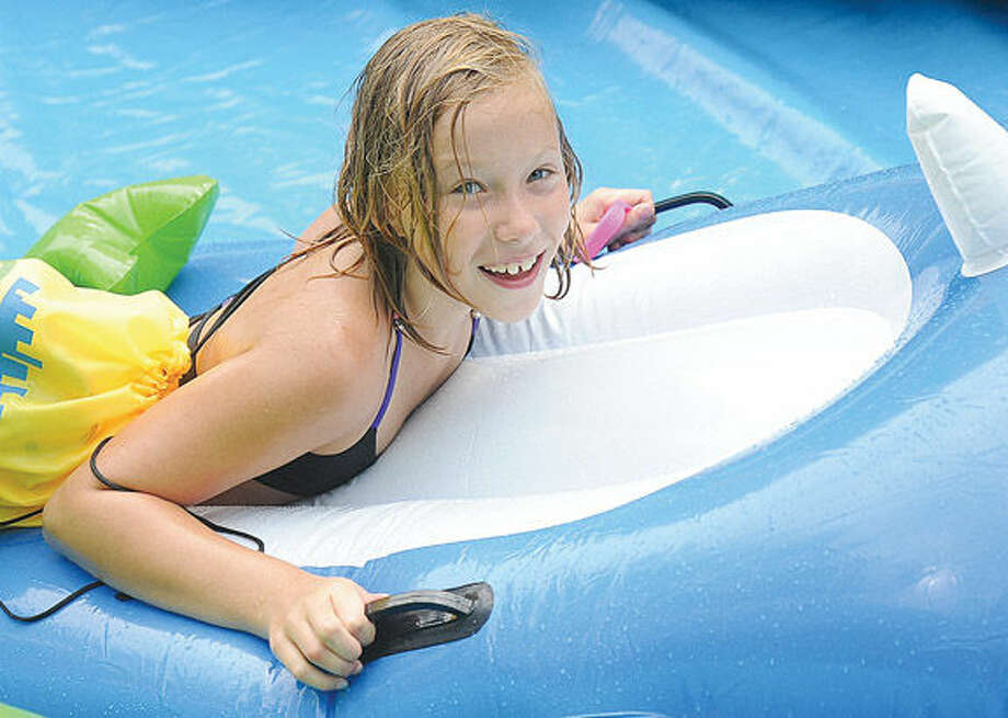 Victoria Typa 9, on her shark raft makes her way down the giant water slide at the Slide City event held in downtown Stamford. Hour photo/Matthew Vinci