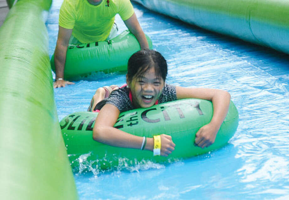 Michelle Ferone 10, heading to the bottom of the giant water slide at the Slide City event held in downtown Stamford. Hour photo/Matthew Vinci