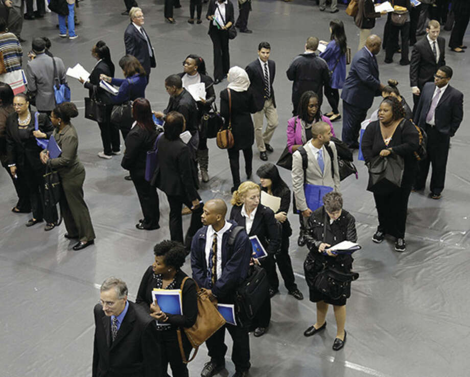 AP file photo/Mark LennihanIn this Oct. 8 file photo, job hunters line up for interviews at an employment fair sponsored by the New York State Department of Labor in the Brooklyn borough of New York.