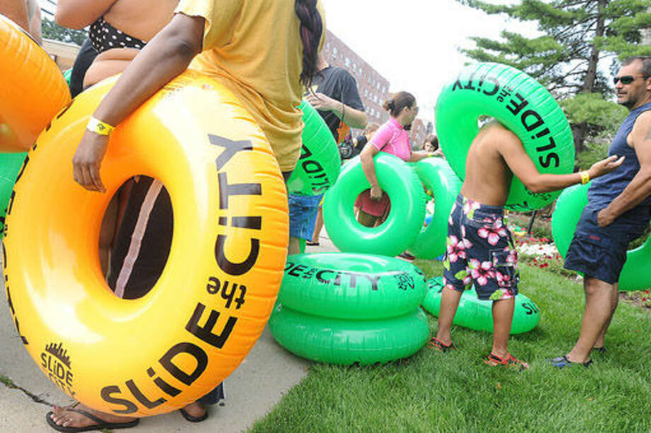 Crowds gather to hit the giant water slide at the Slide City event held in downtown Stamford. Hour photo/Matthew Vinci