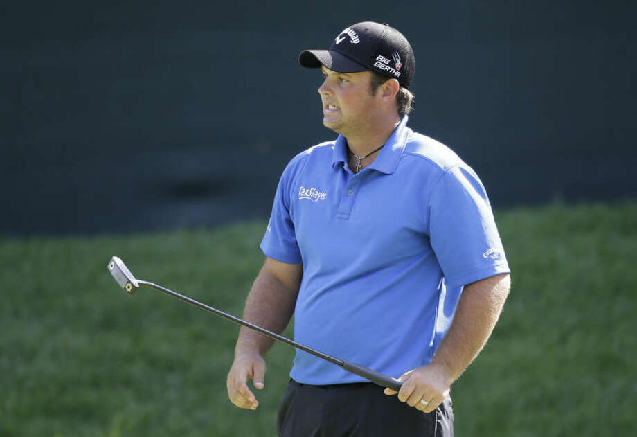 Patrick Reed reacts after missing a birdie opportunity on the 15th green during the third round of the Quicken Loans National PGA golf tournament, Saturday, June 28, 2014, in Bethesda, Md. Reed made par on the hole. (AP Photo/Patrick Semansky)