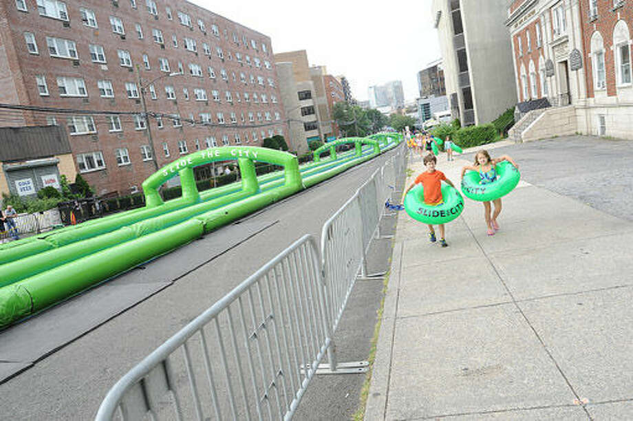 The giant water slide at the Slide City event held in downtown Stamford. Hour photo/Matthew Vinci