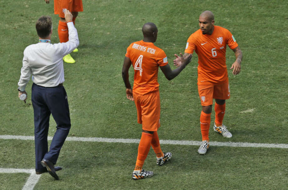 Netherlands' Nigel de Jong, right, is substituted by his teammate Bruno Martins Indi as head coach Louis van Gaal, left, gives instructions during the World Cup round of 16 soccer match between the Netherlands and Mexico at the Arena Castelao in Fortaleza, Brazil, Sunday, June 29, 2014. (AP Photo/Themba Hadebe)