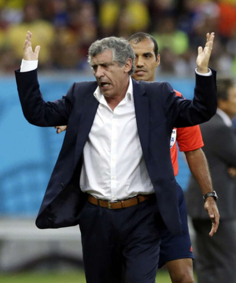 Greece's head coach Fernando Santos gestures during the World Cup round of 16 soccer match between Costa Rica and Greece at the Arena Pernambuco in Recife, Brazil, Sunday, June 29, 2014. (AP Photo/Ricardo Mazalan)