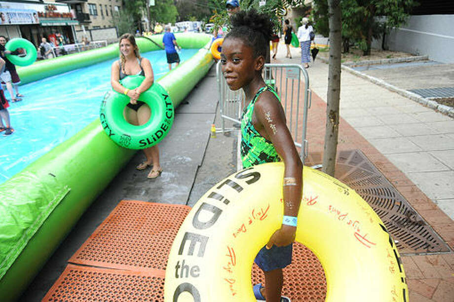 Crowds gather Sunday for the giant water slide at the Slide City event held in downtown Stamford. Hour photo/Matthew Vinci