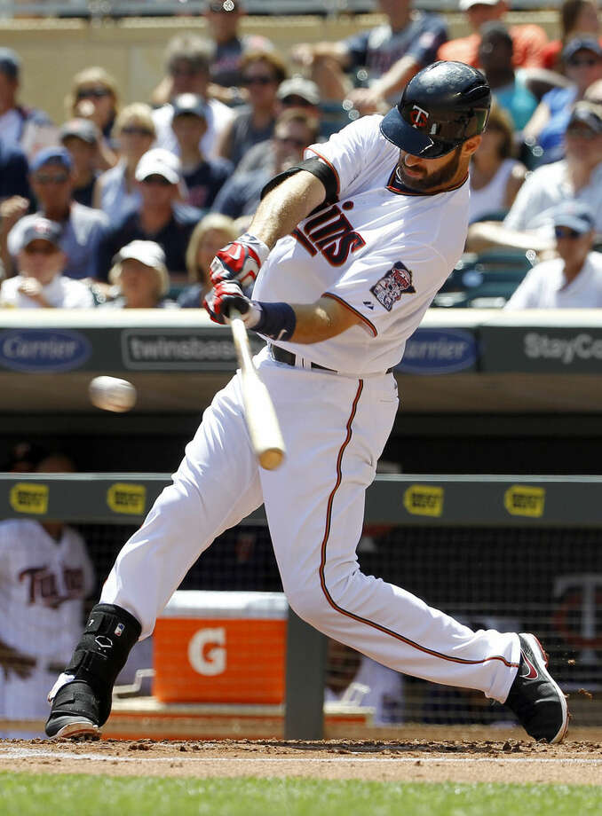 Minnesota Twins' Joe Mauer hits a single during the first inning of a baseball game in Minneapolis, Sunday, July 26, 2015. (AP Photo/Ann Heisenfelt)