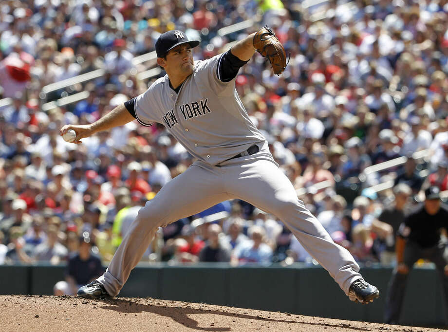 New York Yankees starting pitcher Nathan Eovaldi delivers to the Minnesota Twins during the first inning of a baseball game in Minneapolis, Sunday, July 26, 2015. (AP Photo/Ann Heisenfelt)