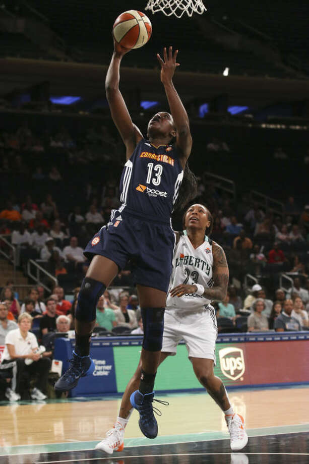 Connecticut Sun forward Chiney Ogwumike (13) shoots over New York Liberty guard Cappie Pondexter (23) during the first half of a WNBA basketball game at Madison Square Garden in New York, Sunday, June 29, 2014. (AP Photo/John Minchillo)
