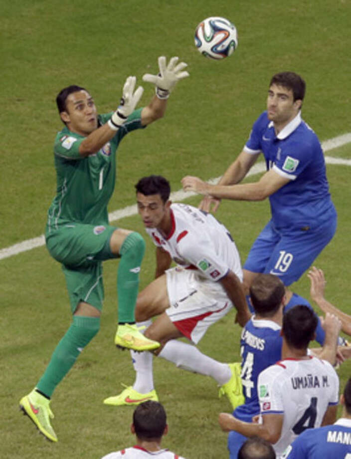 Costa Rica's goalkeeper Keylor Navas makes a save during the World Cup round of 16 soccer match between Costa Rica and Greece at the Arena Pernambuco in Recife, Brazil, Sunday, June 29, 2014. (AP Photo/Hassan Ammar)