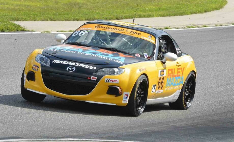 Hour Photo/Alex von Kleydorff. Stamford's Riley Mazda team with drivers AJ and Jameson Riley at the Northeast Grand Prix at Lime Rock Park