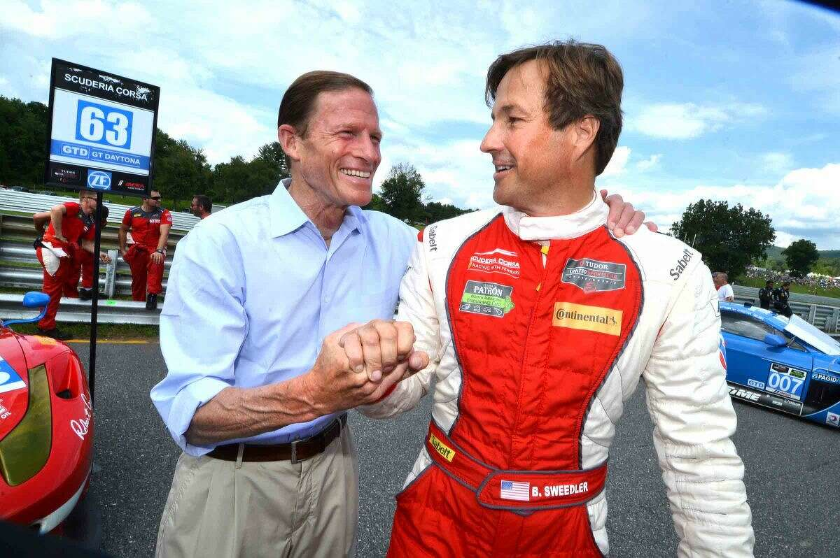 Hour Photo/Alex von Kleydorff.On the grid in Pit Lane, U.S Senator and Grand Marshal Richard Blumenthlal gives Westport's Bill Sweedler a good luck handshake just before he takes the green flag in the TUDOR United Sportscar Championship Northeast Grand Rrix at Lime Rock Park. Sweedler with co driver Townsend Bell Finished 9th in their Team Scuderia Corsa Ferrari 458 Italia which keeps them in third place overall in their GT Daytona class. The series next stop is at Road America in Elkart Lake Wisconsin