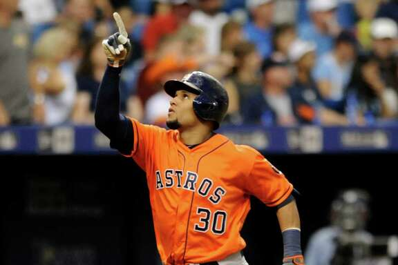 Houston Astros' Carlos Gomez (30) heads for home after hitting a solo home run off Tampa Bay Rays starter Chris Archer during the seventh inning of a baseball game, Saturday, June 11, 2016, in St. Petersburg, Fla. (AP Photo/Steve Nesius)