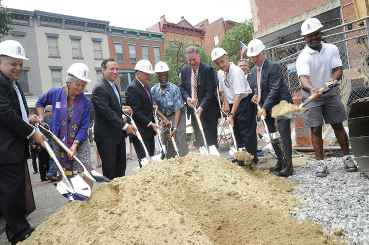 Groundbreaking for the The SONO Pearl Apartments in South Norwalk Monday, from left, Felix Serrano, Chairman of Norwalk Redevelopment Agency, Reverend Holly Adams, United Congregational Church, State Senator Bob Duff, Norwalk Mayor Harry Rilling, Nate Sumpter, Norwalk Commissioner, Ed Musante, President at Greater Norwalk Chamber of Commerce, Joe Santo Chair of the Norwalk Zoning Commision, Thomas L. Rich, President and CEO of F.D.Rich Company and Councilman Travis Simms. Hour photo/Matthew Vinci