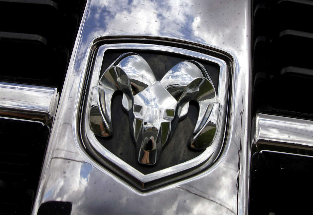 FILE - This July 13, 2011, file photo shows the Ram logo on a Ram pickup truck at a dealership in Hillsboro, Ore. Fiat Chrysler will buy back about 300,000 Ram pickup trucks in the biggest such action in U.S. history as part of a deal with U.S. safety regulators to settle legal problems in about two-dozen recalls, two people briefed on the matter say. (AP Photo/Don Ryan, File)