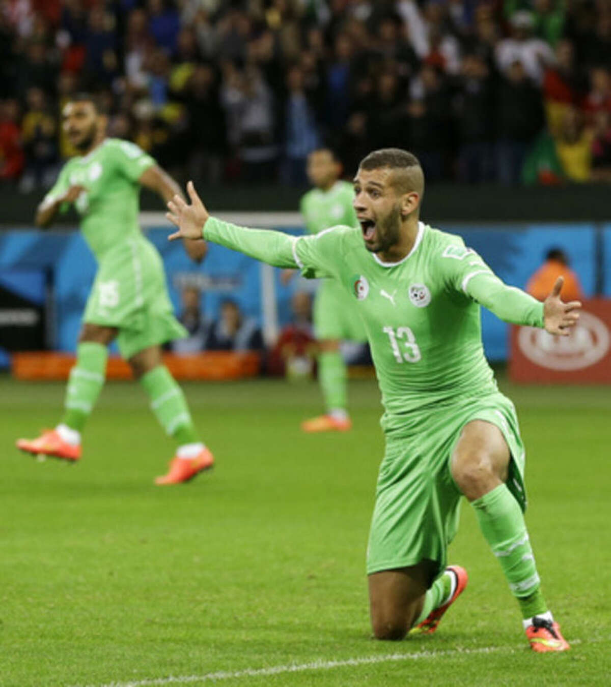 Algeria's Islam Slimani pleads to the referee for a call on a play during the World Cup round of 16 soccer match between Germany and Algeria at the Estadio Beira-Rio in Porto Alegre, Brazil, Monday, June 30, 2014. (AP Photo/Kirsty Wigglesworth)