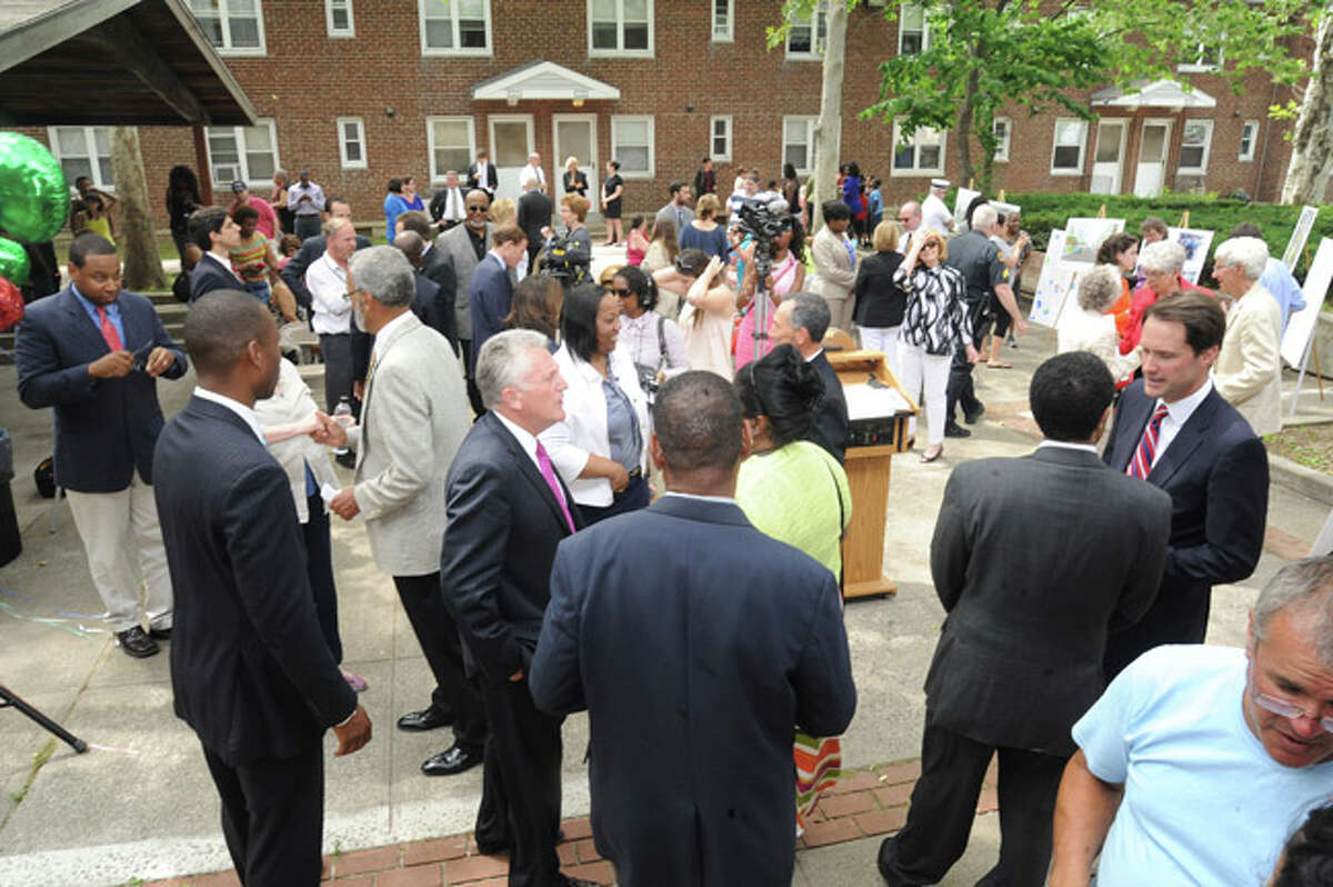 Residents and members of Congress, Councilman, police and clergy meet at Norwalk's Washington Village Monday as 30 million dollars was announced to rebuild the area. Hour photo/Matthew Vinci
