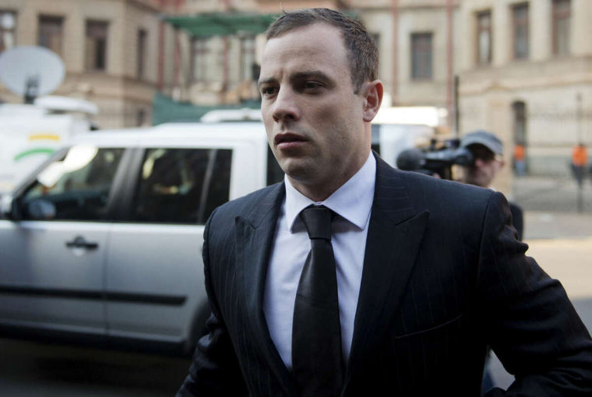 Oscar Pistroius arrives at court in Pretoria, South Africa, Monday, June 30, 2014. The murder trial resumed after one month during which mental health experts evaluated the athlete to determine if he has an anxiety disorder that could have influenced his actions on the night he killed his girlfriend Reeva Steenkamp. (AP Photo)