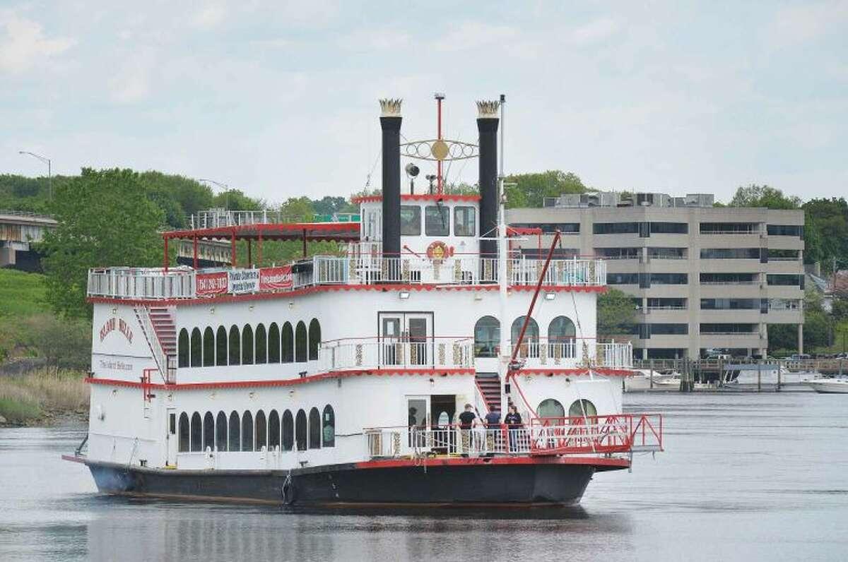 Hour Photo/Alex von Kleydorff The Island Belle makes its way down the Norwalk River on Monday