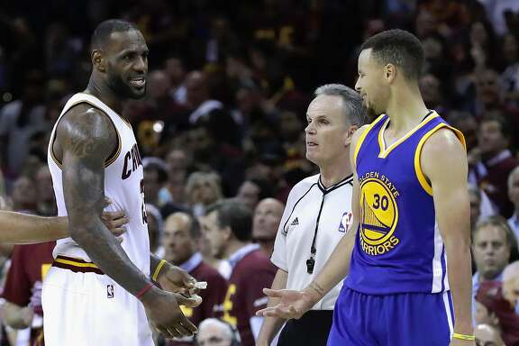 CLEVELAND, OH - JUNE 10:  LeBron James #23 of the Cleveland Cavaliers and Stephen Curry #30 of the Golden State Warriors exchange words during a time out during the fourth quarter in Game 4 of the 2016 NBA Finals at Quicken Loans Arena on June 10, 2016 in Cleveland, Ohio. NOTE TO USER: User expressly acknowledges and agrees that, by downloading and or using this photograph, User is consenting to the terms and conditions of the Getty Images License Agreement.  (Photo by Ronald Martinez/Getty Images)