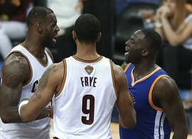 Golden State Warriors forward Draymond Green, right, and Cleveland Cavaliers forward LeBron James, left, argue while being separated by Channing Frye (9) during the second half of Game 4 of basketball's NBA Finals in Cleveland, Friday, June 10, 2016. The Warriors won 108-97. (AP Photo/Ron Schwane)