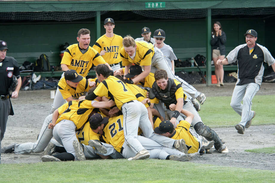 Amity celebrates their win over Fairfield Warde High School in the Class LL state baseball championship game at Palmer Field in Middletown, CT on Saturday, June 11, 2016. Photo: Amy Mortensen / For Hearst Connecticut Media