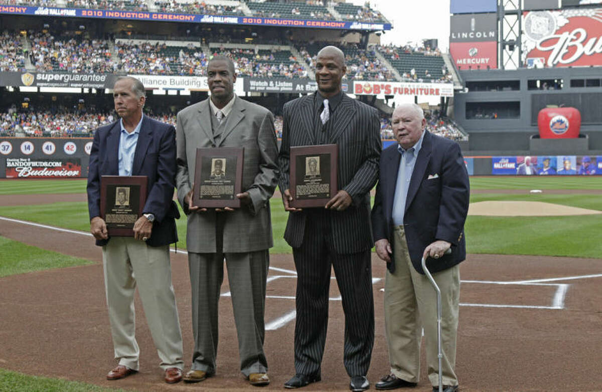 FILE - In this Aug. 1, 2010 file photo, from left, former New York Mets manager Davey Johnson, former Mets pitcher Dwight