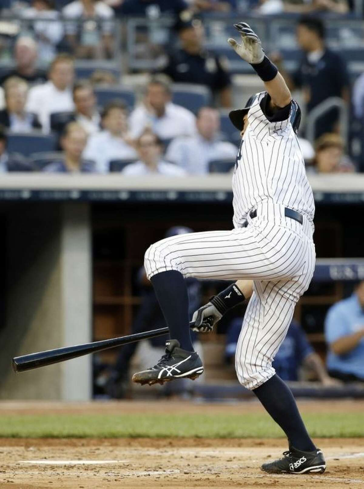 New York Yankees Ichiro Suzuki leaps after he was hit by a third-inning pitch thrown by Tampa Bay Rays starting pitcher Chris Archer in a baseball game at Yankee Stadium in New York, Monday, June 30, 2014. (AP Photo/Kathy Willens)