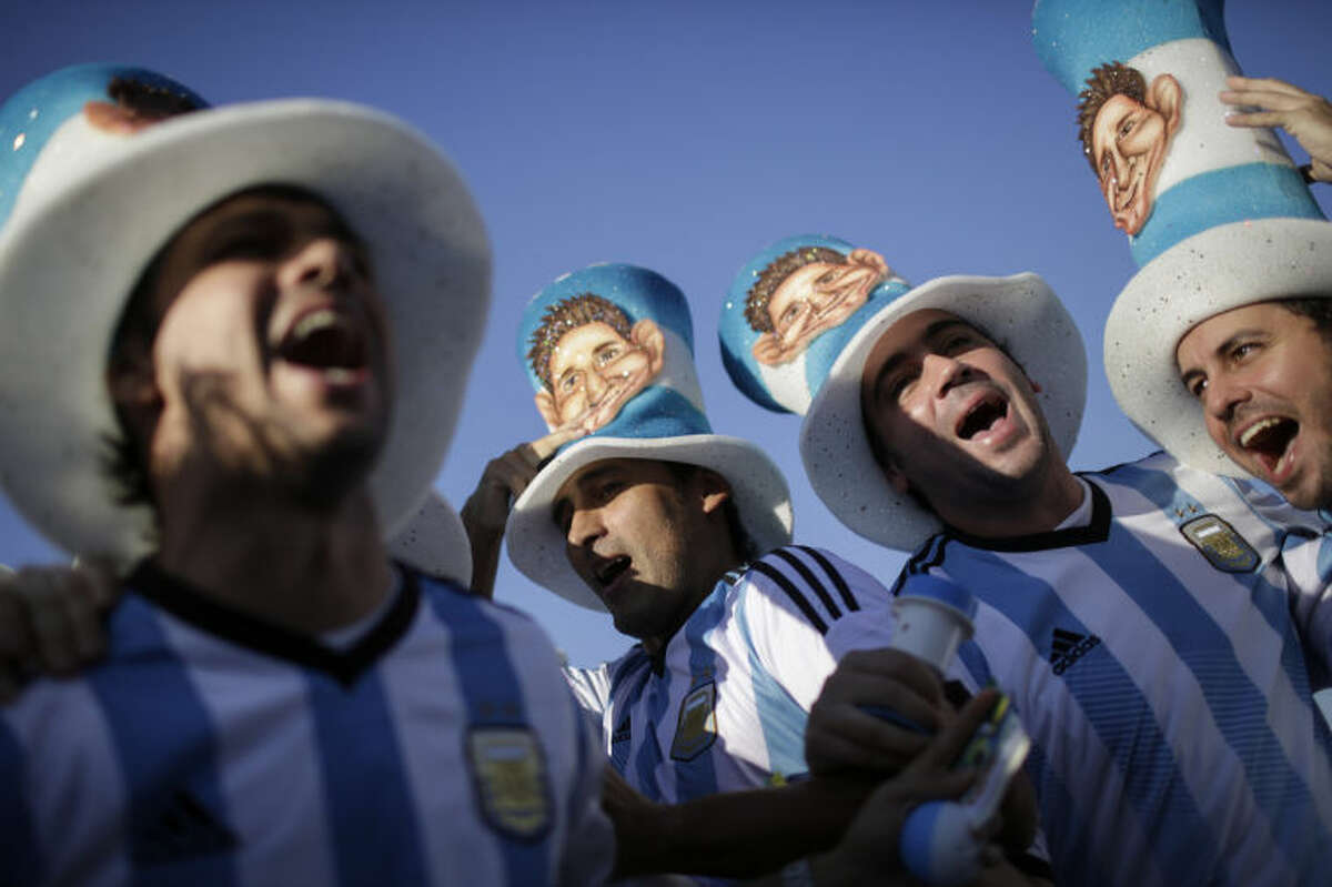 FILE - In this June 15, 2014 file photo, Argentina soccer fans cheer outside Maracana Stadium as they arrive to the group F World Cup soccer match between Argentina and Bosnia in Rio de Janeiro, Brazil. Argentine fans have an impressive repertoire of chants and even came up with a new one specifically tailored for the World Cup in Brazil. (AP Photo/Felipe Dana, File)