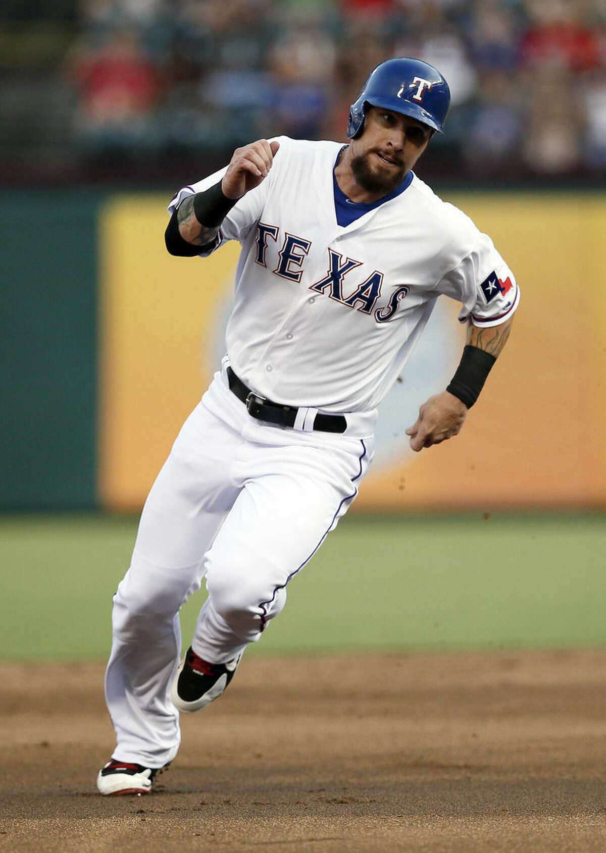 Texas Rangers' Josh Hamilton sprints around second on his way home scoring on a Elvis Andrus double in the second inning of a baseball game against the New York Yankees Monday, July 27, 2015, in Arlington, Texas. (AP Photo/Tony Gutierrez)