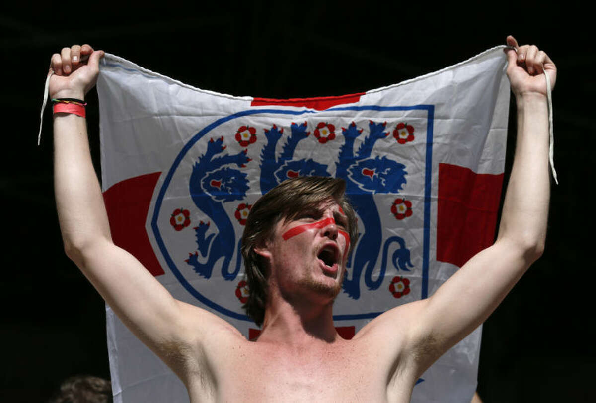FILE - In this June 24, 2014 file photo, an England soccer fan shouts before the group D World Cup soccer match between Costa Rica and England at the Mineirao Stadium in Belo Horizonte, Brazil. Sung to the tune of