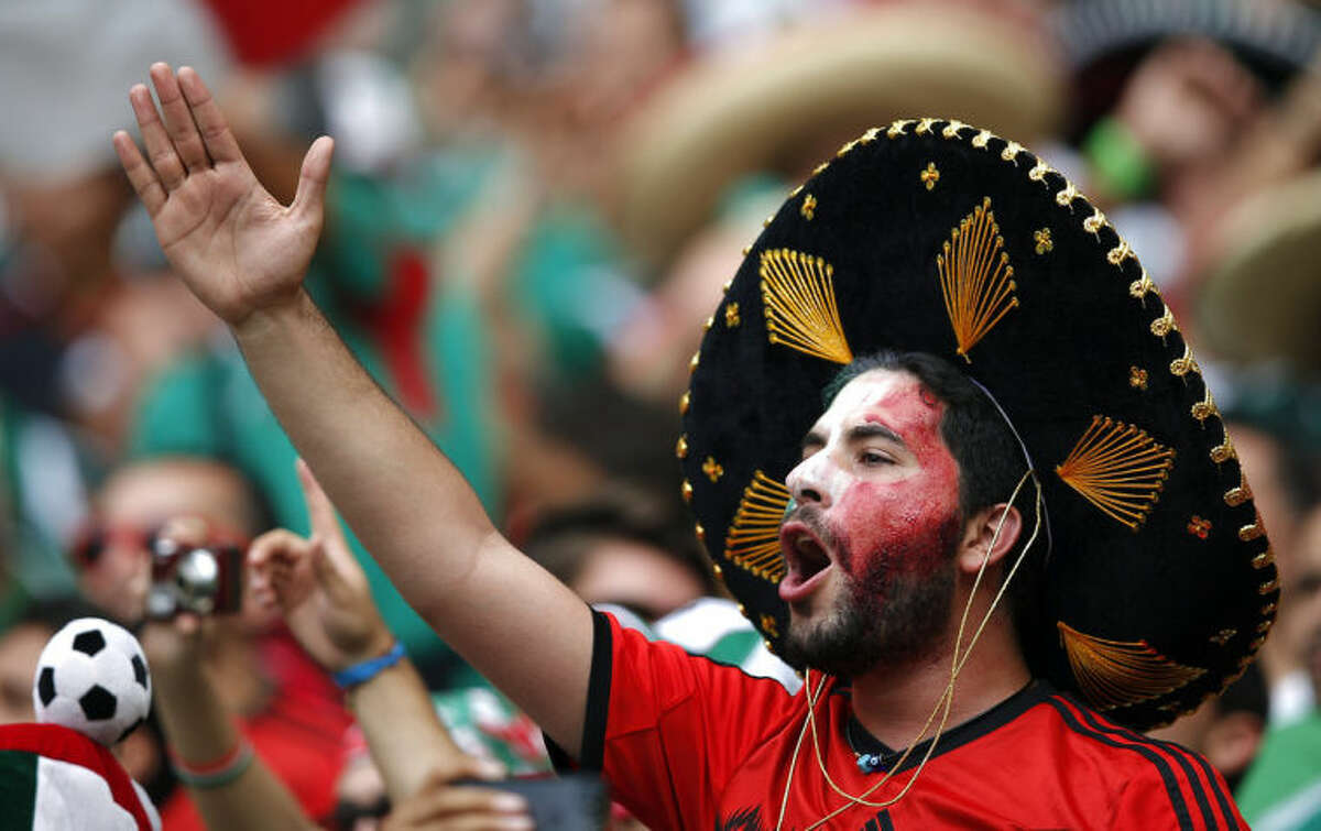 FILE - In this June 17, 2014 file photo, a Mexico soccer fan chants before the group A World Cup soccer match between Brazil and Mexico at the Arena Castelao in Fortaleza, Brazil. The one-word chant that Mexican fans shout during goal kicks has just one purpose: to taunt the opposing goalkeeper. (AP Photo/Eduardo Verdugo, File)