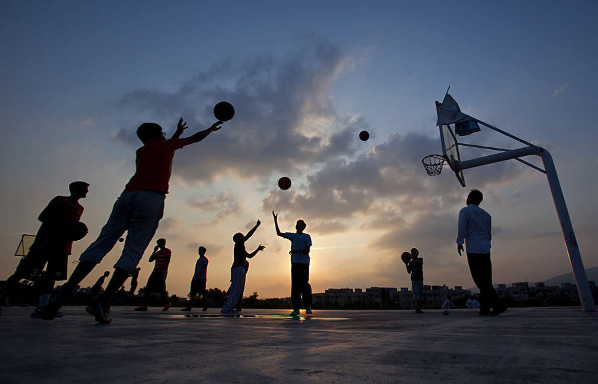 Pakistani youth take part in a volleyball training session at a ground in Islamabad, Pakistan, Tuesday, July 28, 2015. (AP Photo/Anjum Naveed)