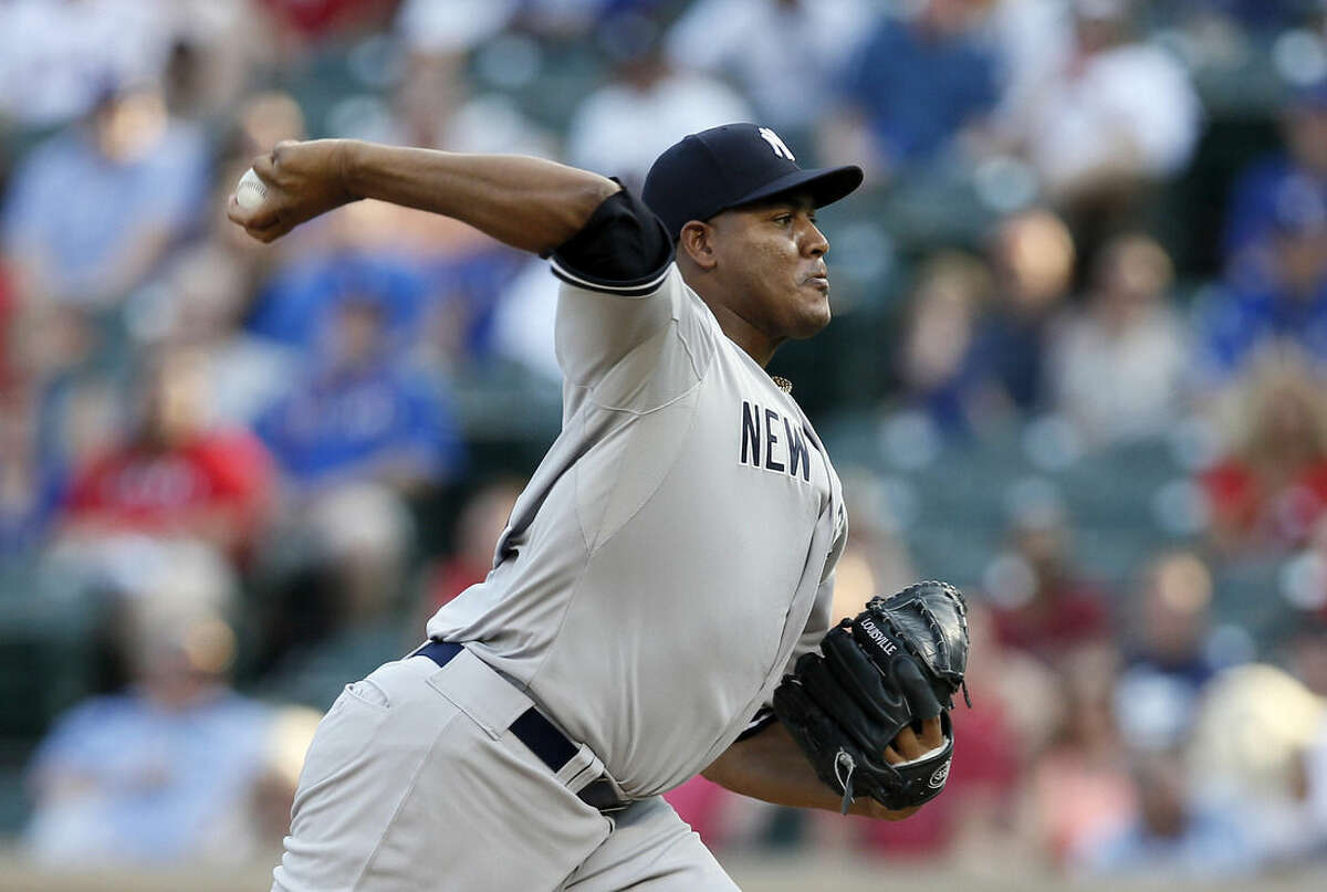 New York Yankees starting pitcher Ivan Nova works against the Texas Rangers in the first inning of a baseball game Monday, July 27, 2015, in Arlington, Texas. (AP Photo/Tony Gutierrez)