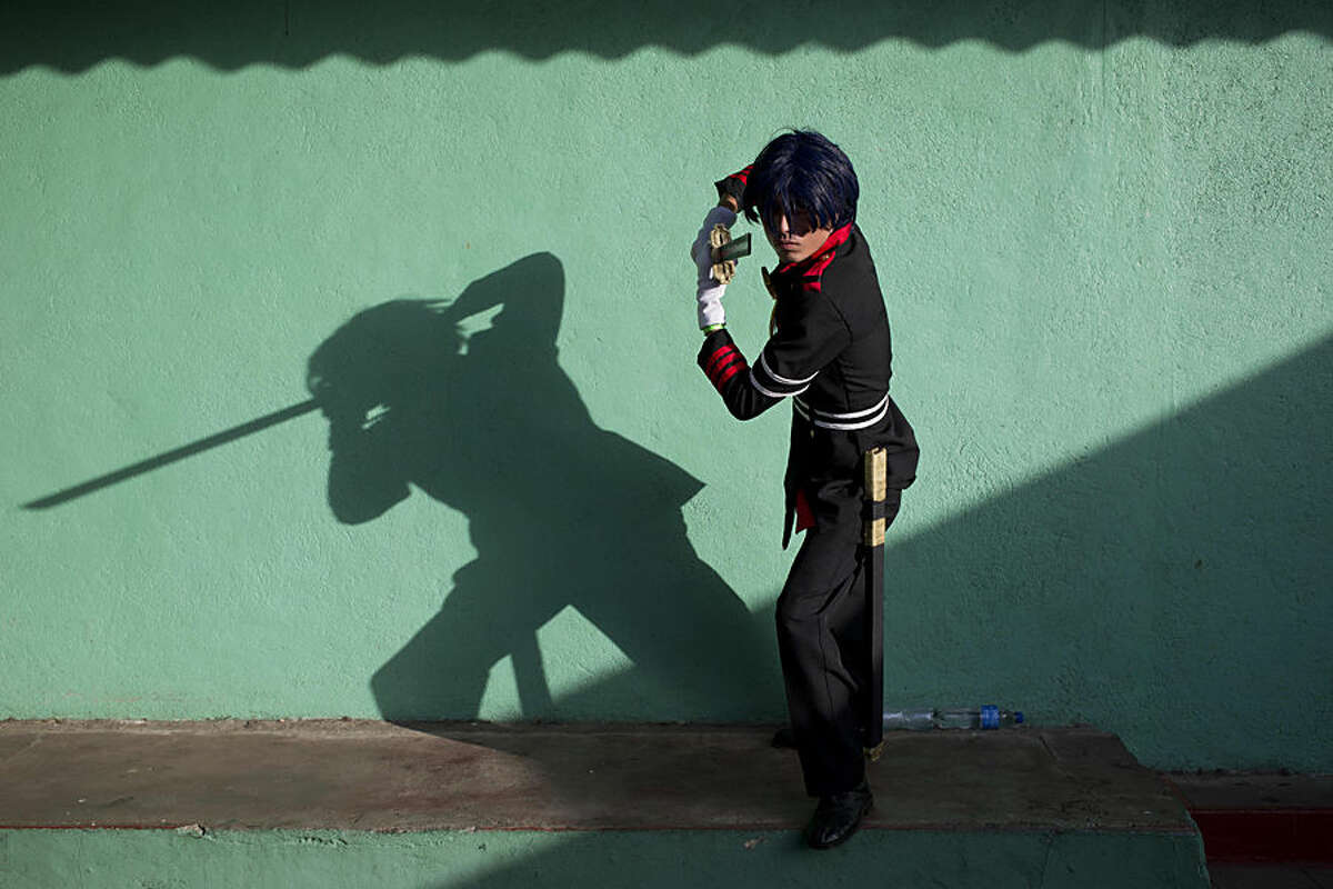 Cosplayer Cesar Salgado, who portrays Owari no Seraph character Guren Ichinose, poses for a portrait during the 4th edition of the MiniCon Anime convention, at the School of Dance, in Managua, Nicaragua, Sunday, July, 26, 2015. (AP Photo/Esteban Felix)