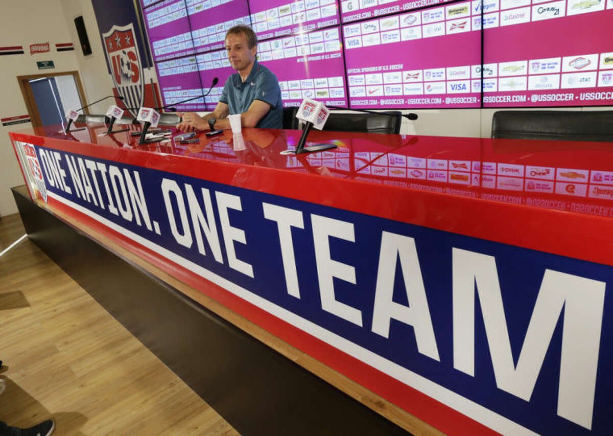 United States head coach Jurgen Klinsmann addresses the media in Sao Paulo, Brazil, Wednesday, July 2, 2014. The U.S. was eliminated from the second round of the 2014 soccer World Cup in a 2-1 loss to Belgium in Salvador, Brazil. (AP Photo/Julio Cortez)