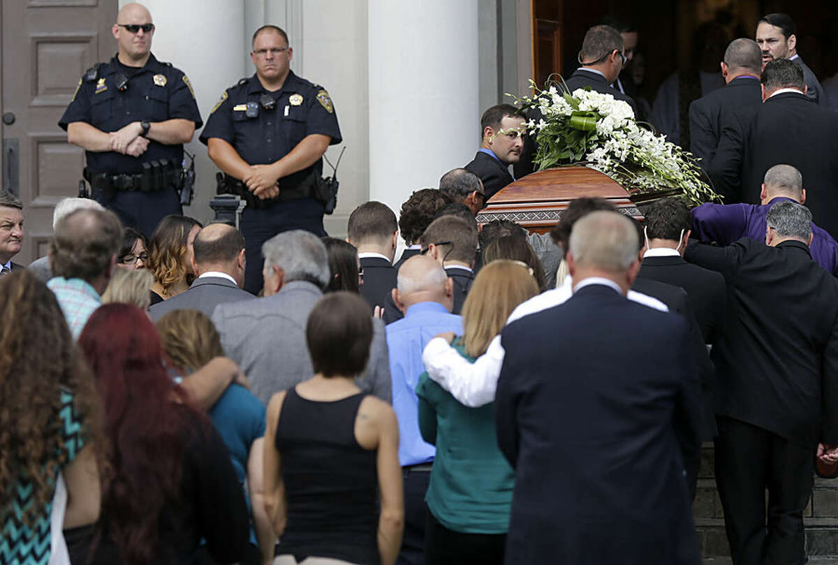 The casket of Mayci Breaux is carried into the Church of the Assumption, for her funeral in Franklin, La., Monday, July 27, 2015. Breaux was one of two people killed in Thursday's movie theater shooting in Lafayette, La. (AP Photo/Gerald Herbert)