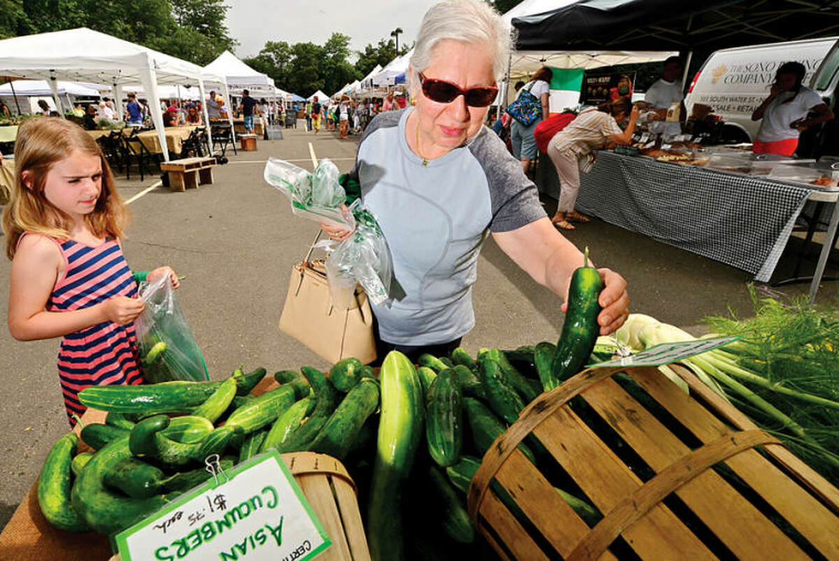 Hour photo / Erik Trautmann Alin Chelico shops for fresh produce with her granddaughter Mia Chelico, 8, at the annual Westport Farmers' Market Thursday morning.